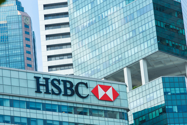 HSBC's profit falls as watchdog looks on