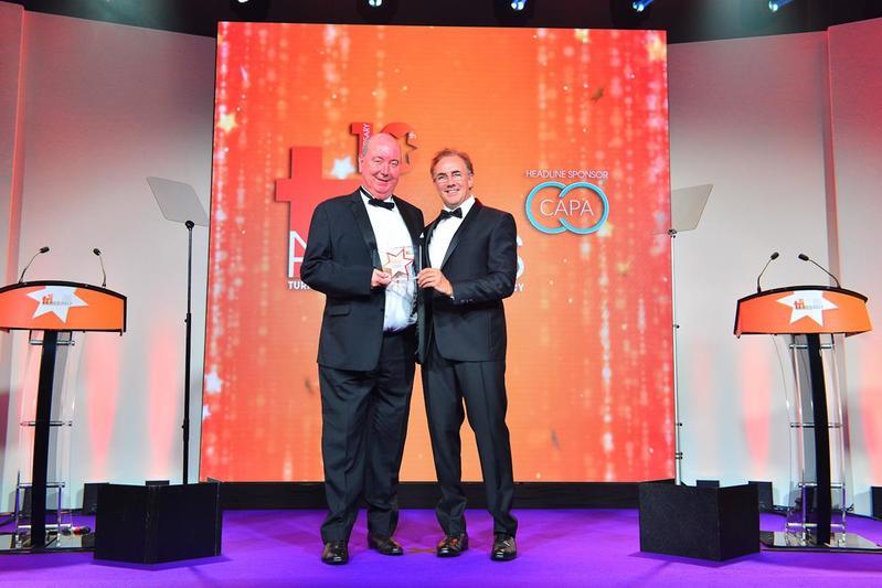 Shay Bannon, left, won the Sabin Award, presented by Tony Lomas from PwC